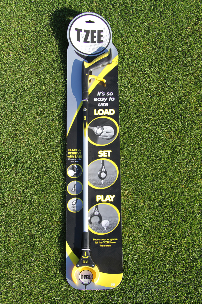 product shot of TZEE golf ball retriever laid on grass