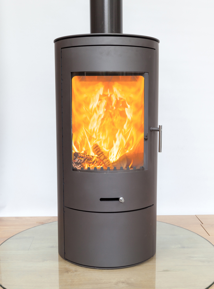 front angle of a lit firestove in a white studio